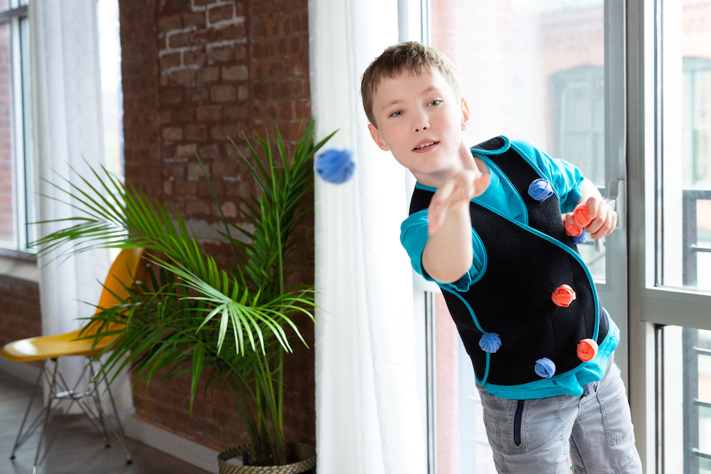 Boy waring compression vest, playing